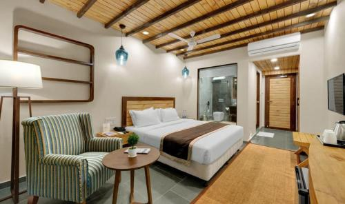 A bed or beds in a room at The Fern Leo Beach Resort , Madhavpur