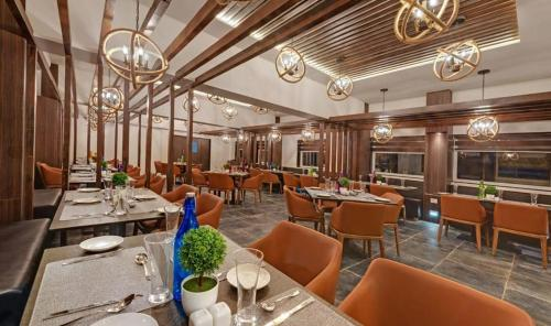 A restaurant or other place to eat at The Fern Leo Beach Resort , Madhavpur