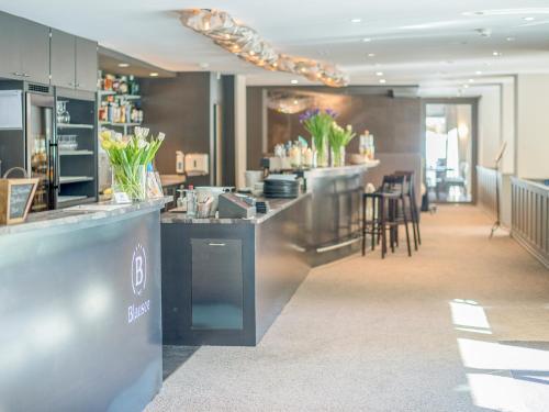 مطعم أو مكان آخر لتناول الطعام في فندق بلوسي