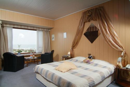 Een bed of bedden in een kamer bij Sint-Laureins