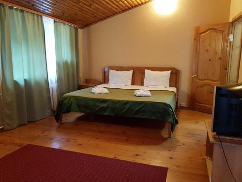 Кровать или кровати в номере Гостиница Очаровательная Полянка
