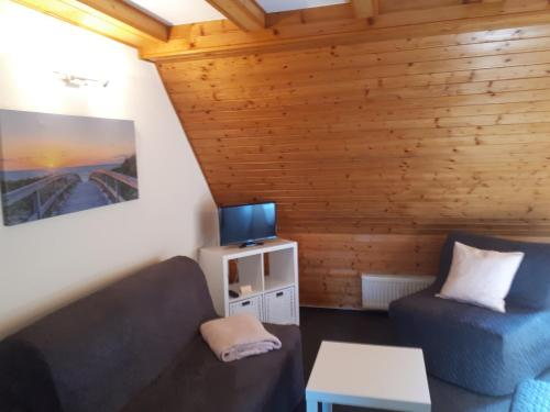 Ein Bett oder Betten in einem Zimmer der Unterkunft Landhaus Levitzow