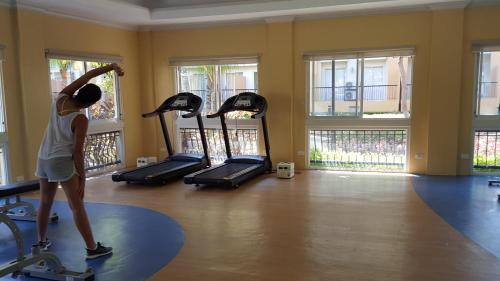 The fitness center and/or fitness facilities at 2 Bedroom Fully Furnish Condo
