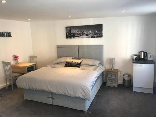 A bed or beds in a room at Fornham Guest House