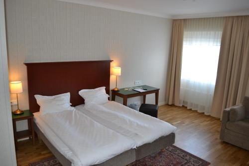 A bed or beds in a room at Hotel Bishops Arms Kiruna