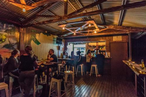 A restaurant or other place to eat at Jackaroo Treehouse Mission Beach