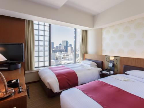 A bed or beds in a room at Hotel Grand Arc Hanzomon