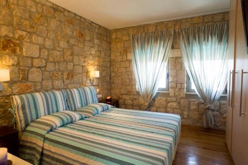 Vuode tai vuoteita majoituspaikassa Blue Dream Luxury Villas