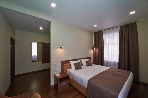 Кровать или кровати в номере Отель Фортон