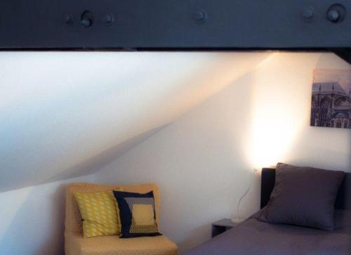 A bed or beds in a room at Relax-Aachener-Boardinghouse-Dachgeschoss