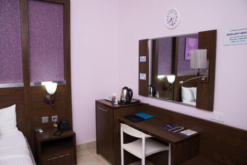 A kitchen or kitchenette at Whitefield Hotels Limited