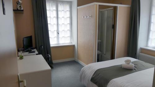 Un ou plusieurs lits dans un hébergement de l'établissement Hôtel Duguesclin