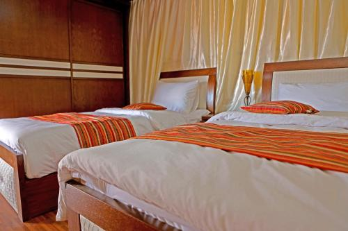 A bed or beds in a room at Sun City Camp