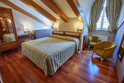 Een bed of bedden in een kamer bij Liberty Hotel