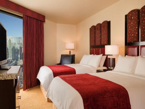 A bed or beds in a room at Marriott's Grand Chateau