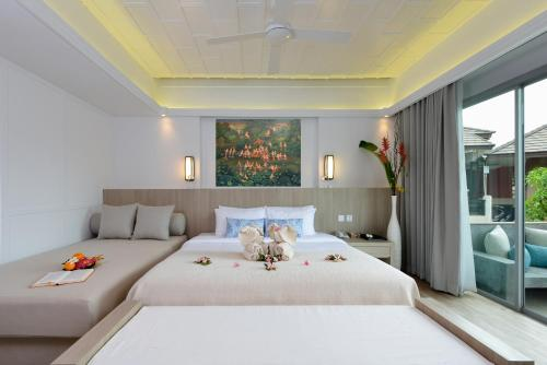 A bed or beds in a room at Twin Lotus Resort and Spa - Adult only - SHA Plus