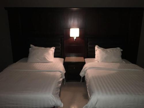 Cama ou camas em um quarto em Al Taif Suites