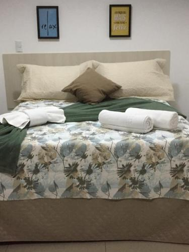 A bed or beds in a room at Hotel Areião