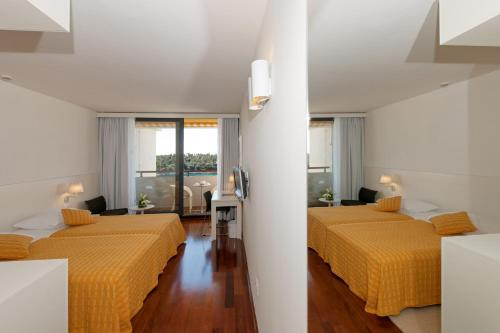 A bed or beds in a room at Island Hotel Istra