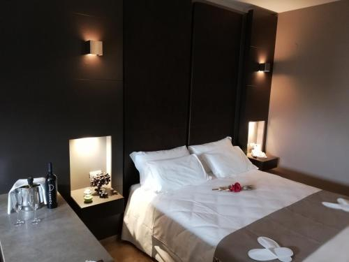 A bed or beds in a room at Wall Art Hotel & Residence