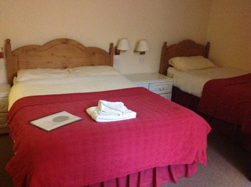 A bed or beds in a room at Highgrove Guest House