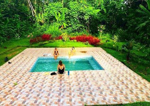 The swimming pool at or close to Lakshmi Ecolodge And Holistic Spa