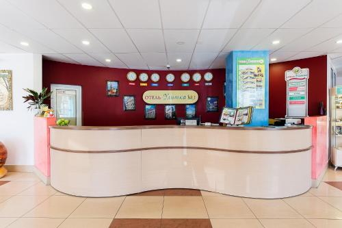 Лобби или стойка регистрации в Отель Улитка