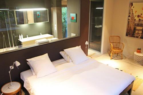 Un ou plusieurs lits dans un hébergement de l'établissement Archibien