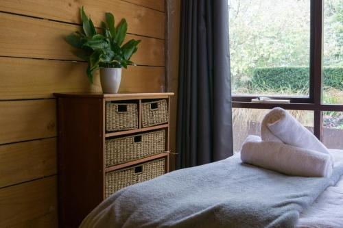 A bed or beds in a room at Blerick Country Retreat