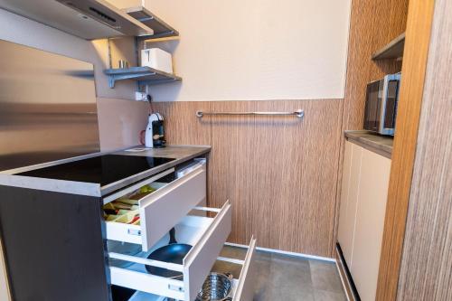 A kitchen or kitchenette at Infotel