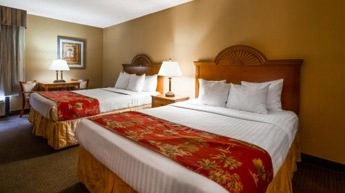 A bed or beds in a room at Best Western Galaxy Inn