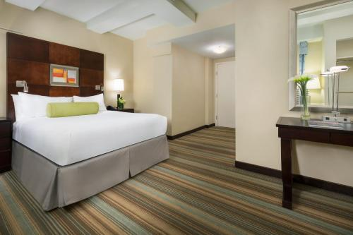 A bed or beds in a room at Hotel Mela Times Square