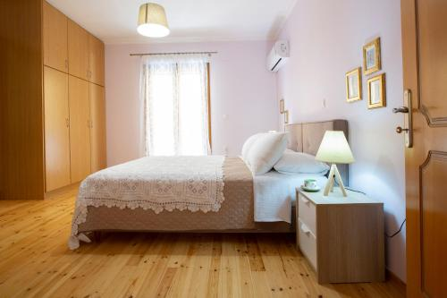 Ένα ή περισσότερα κρεβάτια σε δωμάτιο στο The Lefkadian collection