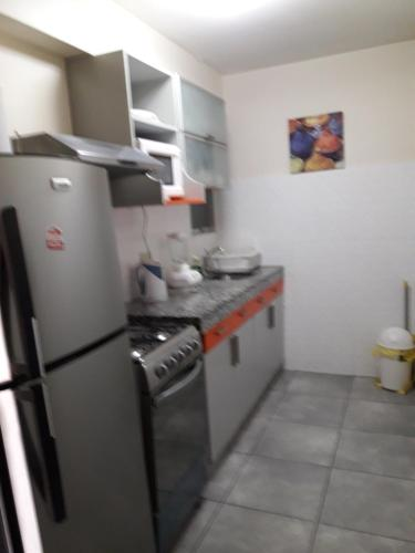 A kitchen or kitchenette at Apartamentos Amoblados de 1 Y 2 dormitorios