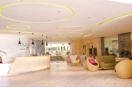 The lobby or reception area at The Muse Hotel
