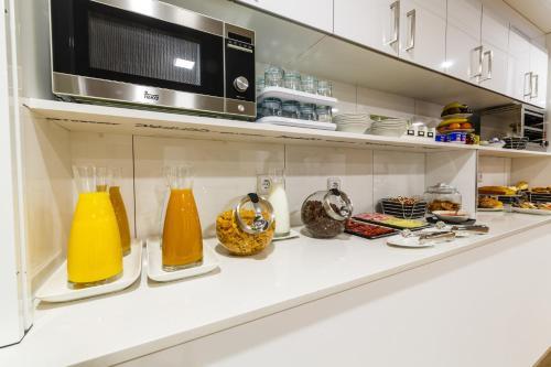 Una cocina o zona de cocina en Suite Home Sardinero