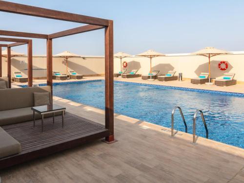 The swimming pool at or near Flora Inn Hotel Dubai Airport