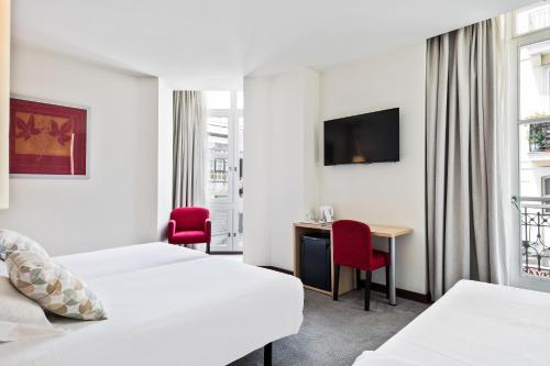 A bed or beds in a room at Abba Santander