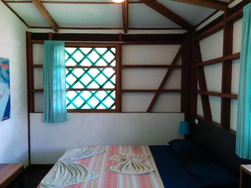 A bed or beds in a room at Pagalù Hostel