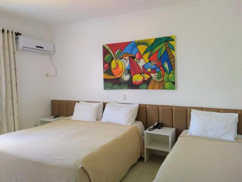 A bed or beds in a room at Simas Praia Hotel