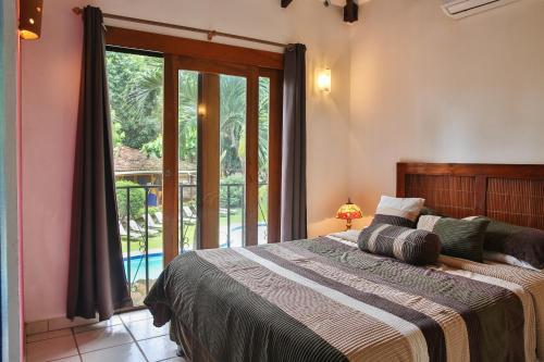 Cama o camas de una habitación en Villas Macondo