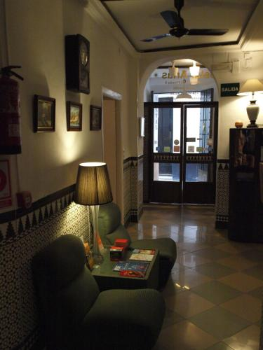 The lobby or reception area at Hostal Arias
