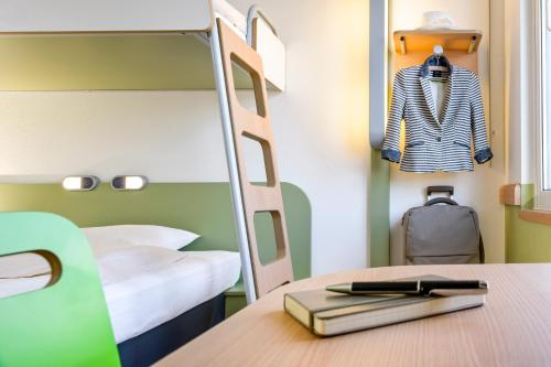A bunk bed or bunk beds in a room at ibis budget Aachen City