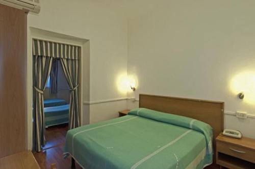 Letto o letti in una camera di Hotel Firenze