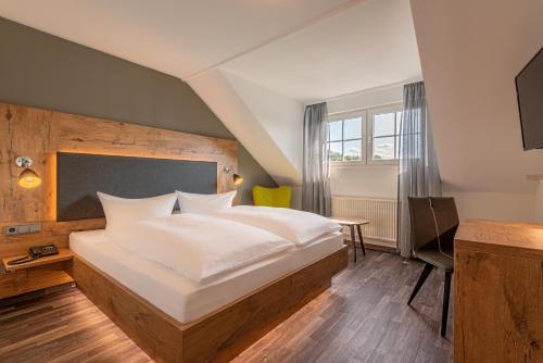 Ein Bett oder Betten in einem Zimmer der Unterkunft Hotel Pfeffermühle