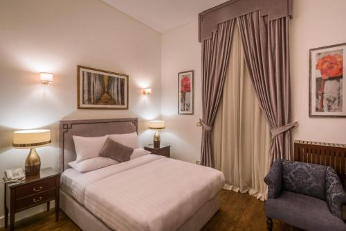 A bed or beds in a room at 1920s Boutique Hotel and Restaurants