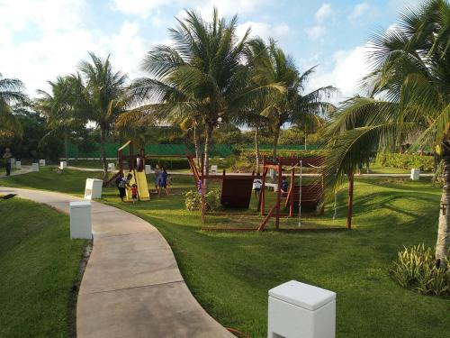 Jardín al aire libre en One bedroom condo on the beach at Amara Cancun