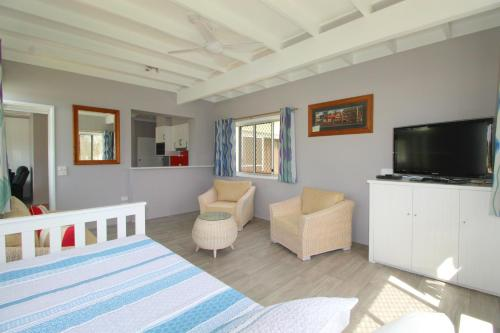 A television and/or entertainment center at Beachfront 6, 25 Willow Street
