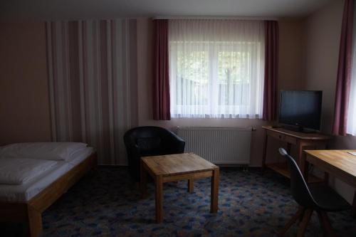 Ein Sitzbereich in der Unterkunft Seminarhotel Jakobsberg