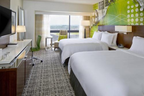 A bed or beds in a room at Renaissance Nashville Hotel
